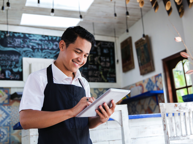 Business person reviewing things on a tablet