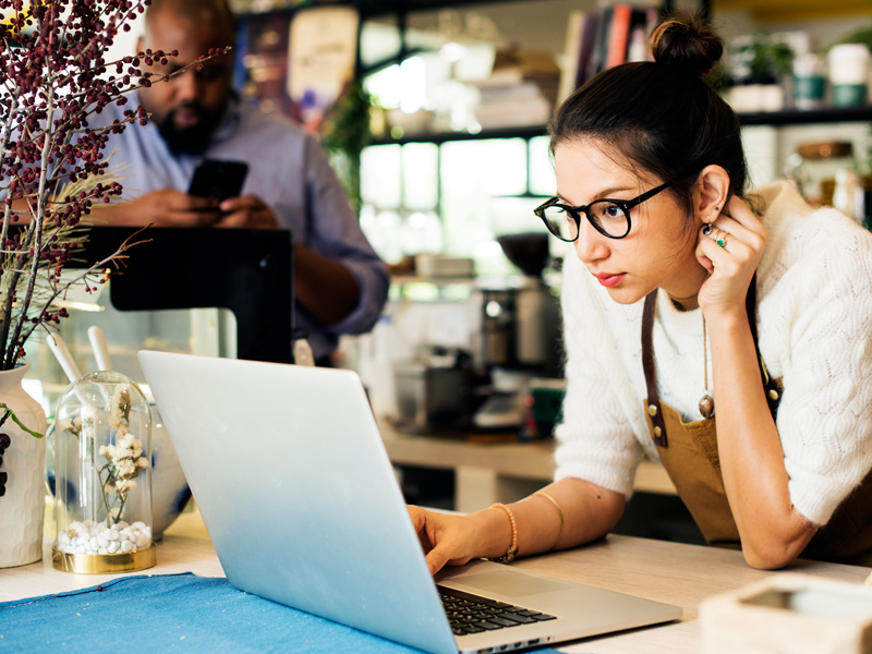 Business woman checking account balances with online banking