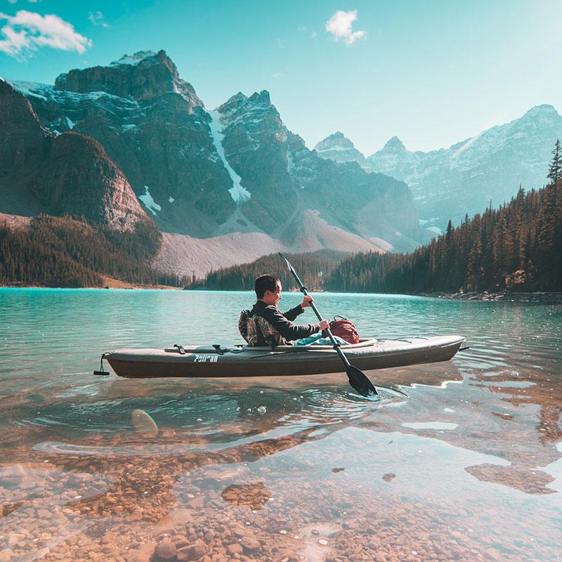Man kayaking in the mountains