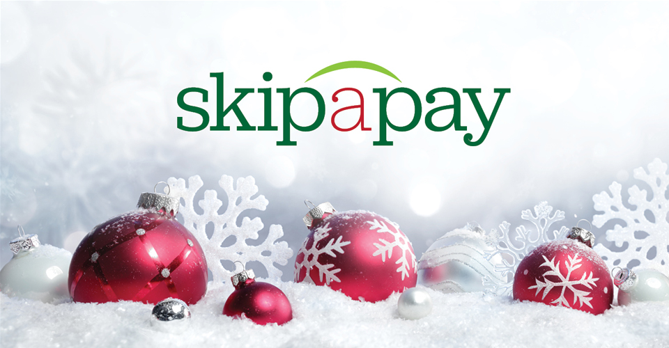 Skip-A-Pay red and white Christmas ornaments in snow