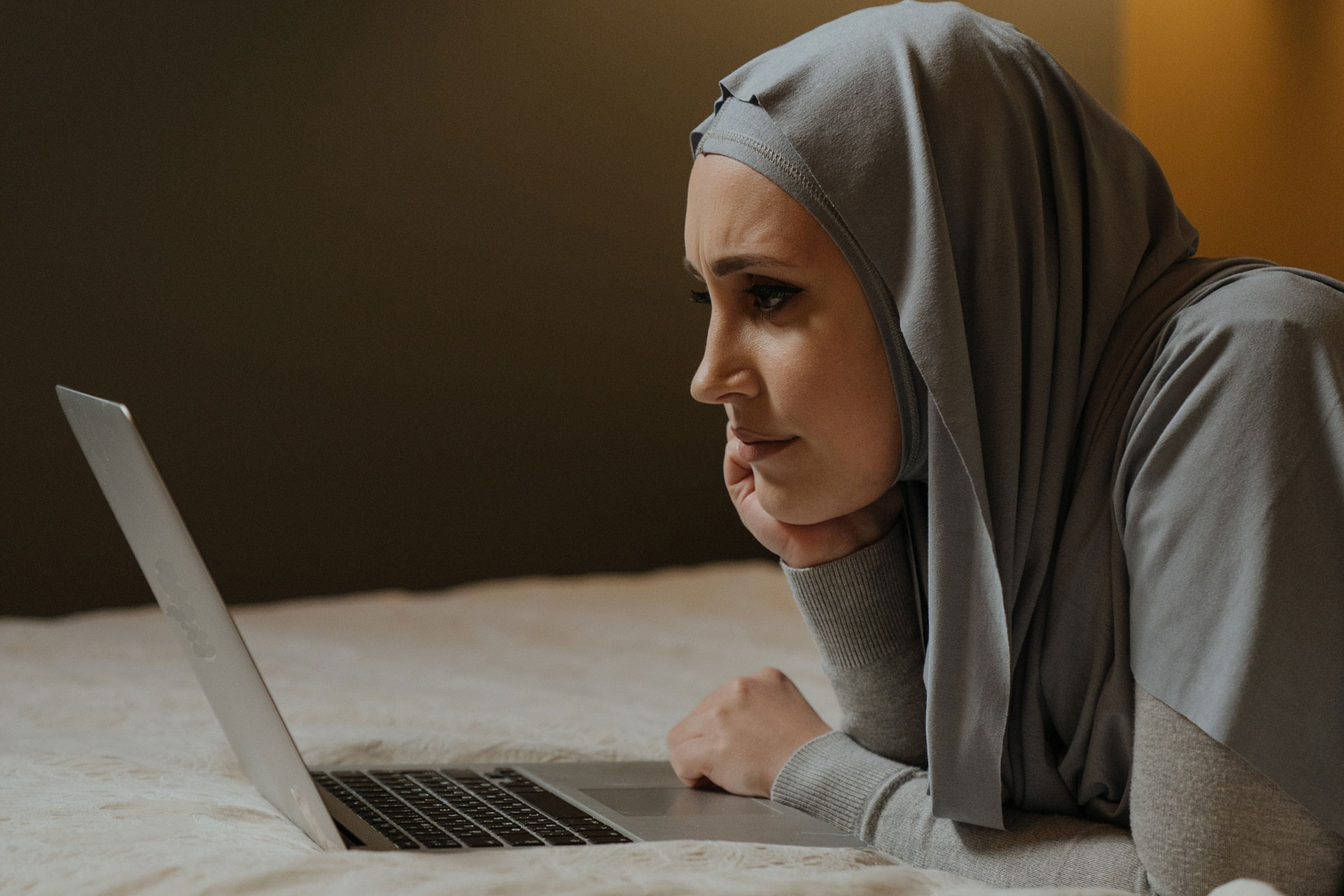 Woman in Gray Hijab using a laptop