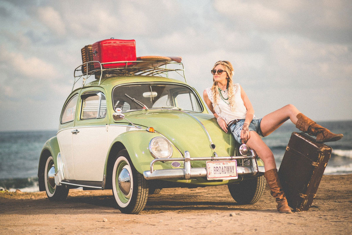 Girl Leaning on car at beach