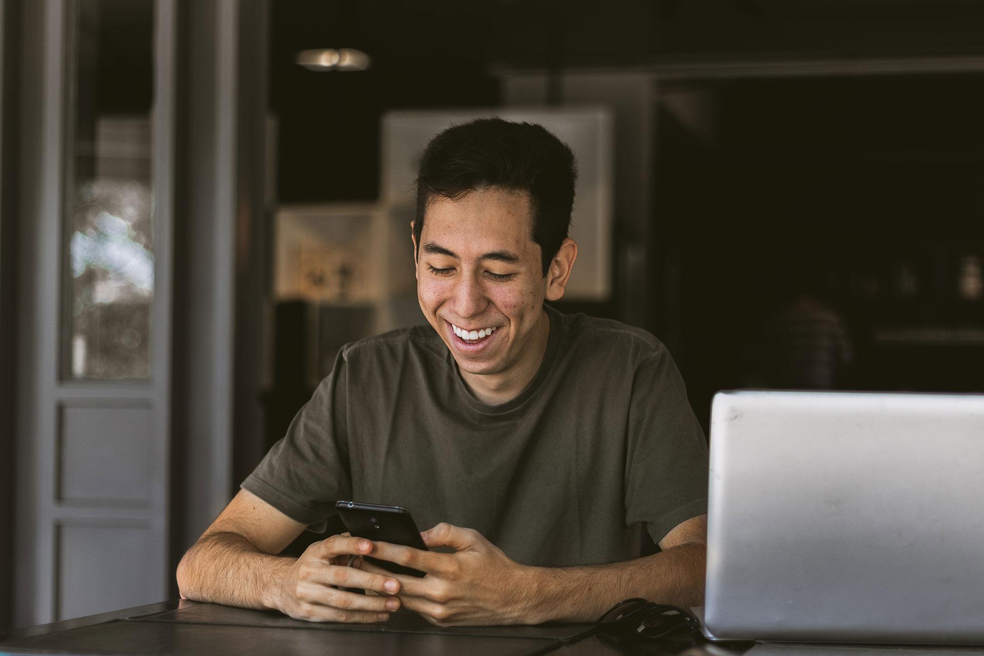 Male-Phone-Computer-Happy